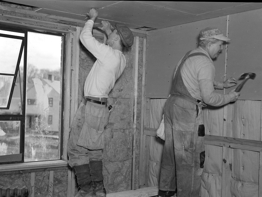 Installing wallboard in a house at the Greenhills project, Ohio. Note sound proofing and insulation feb. 1937 russell lee
