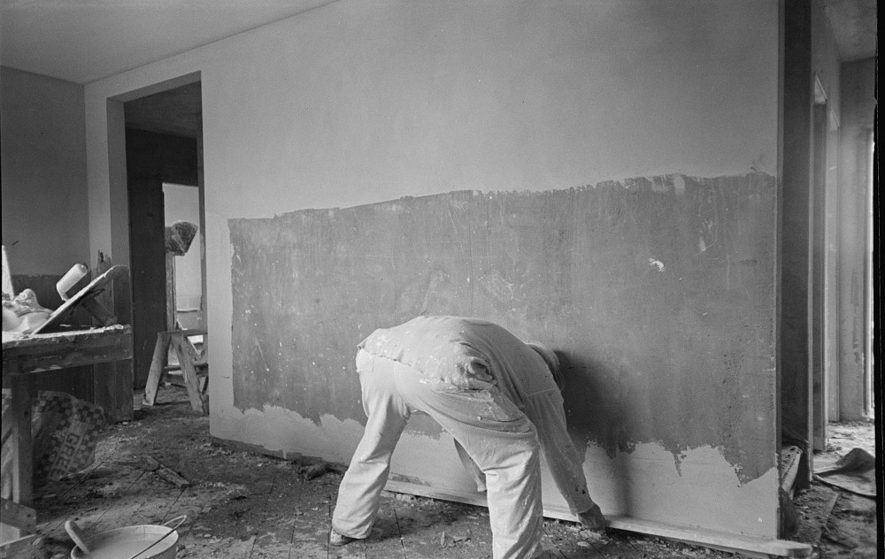 Man plastering wall in Greenhills, Ohio house feb. 1937 russell lee