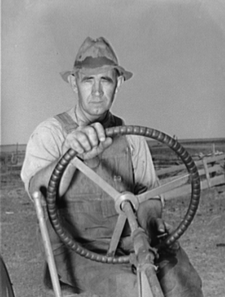 Mr. Germeroth, FSA (Farm Security Administration) client, at wheel of tractor which he bought with FSA loan. Sheridan County, Kansas