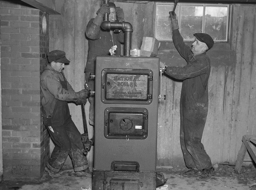 Plumbers at work in the basement of a house on the Greenhills project, Ohio feb. 1937 russell lee