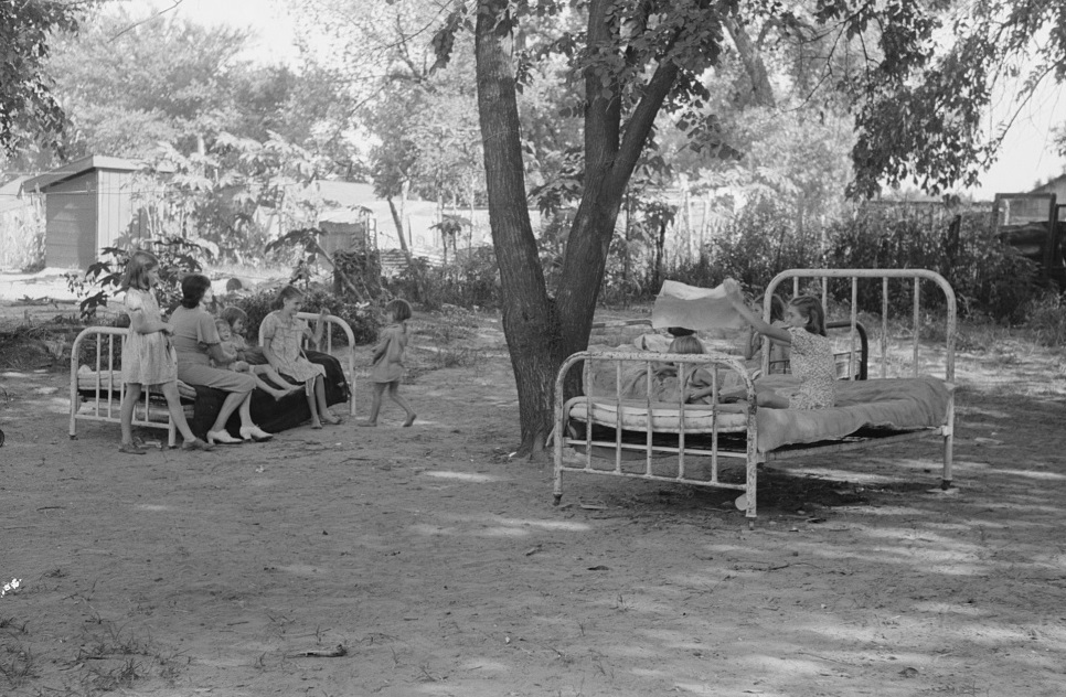 Beds in backyard of family living in community camp, Oklahoma City, Oklahoma