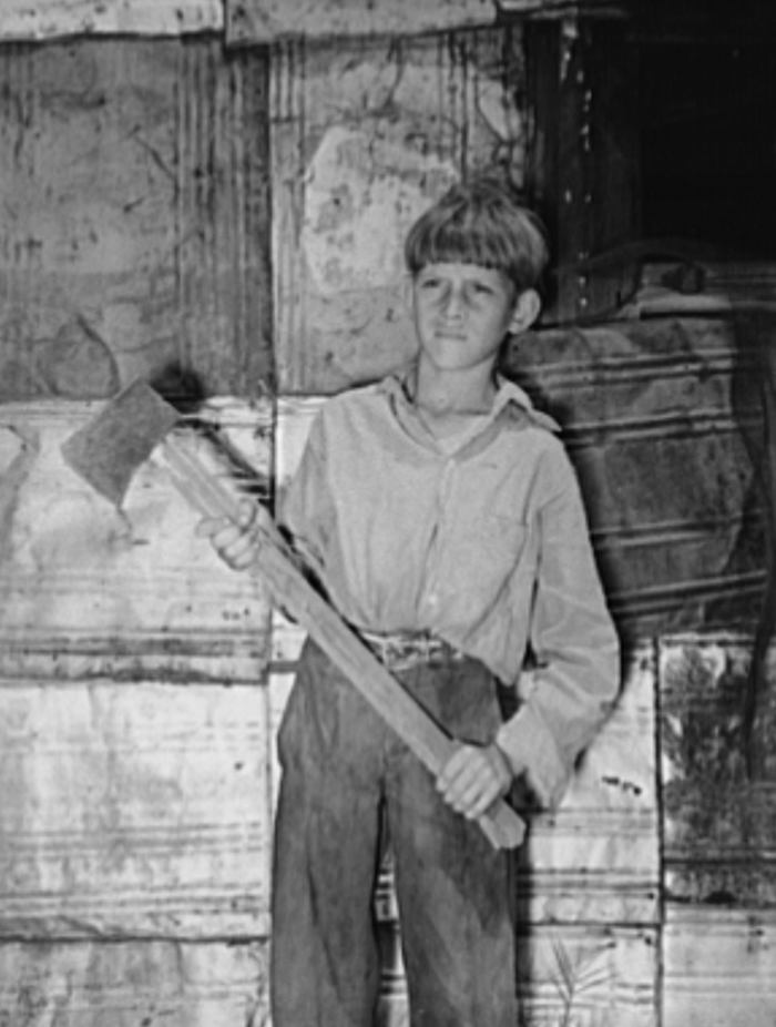 Boy living in Mays Avenue camp with homemade ax. Oklahoma City, Oklahoma