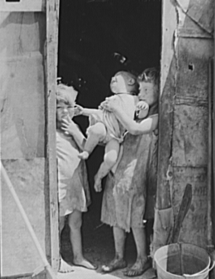 Children of Mays Avenue camp dressed in old sacks. Their father is a trasher. Oklahoma City, Oklahoma