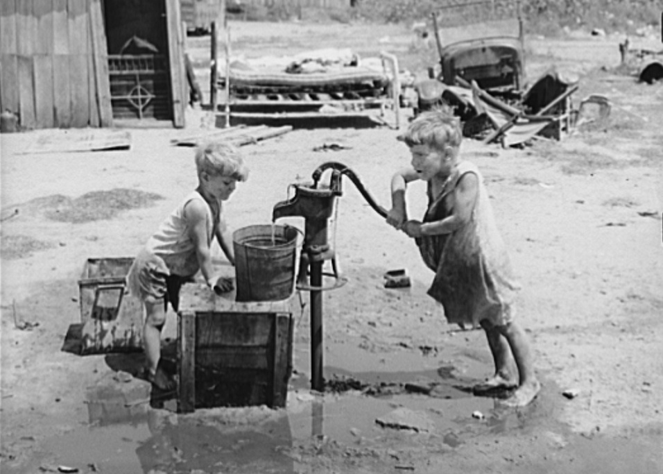 Children of Mays Avenue camp pumping water from thirty-foot well which supplies about a dozen families. Oklahoma City,