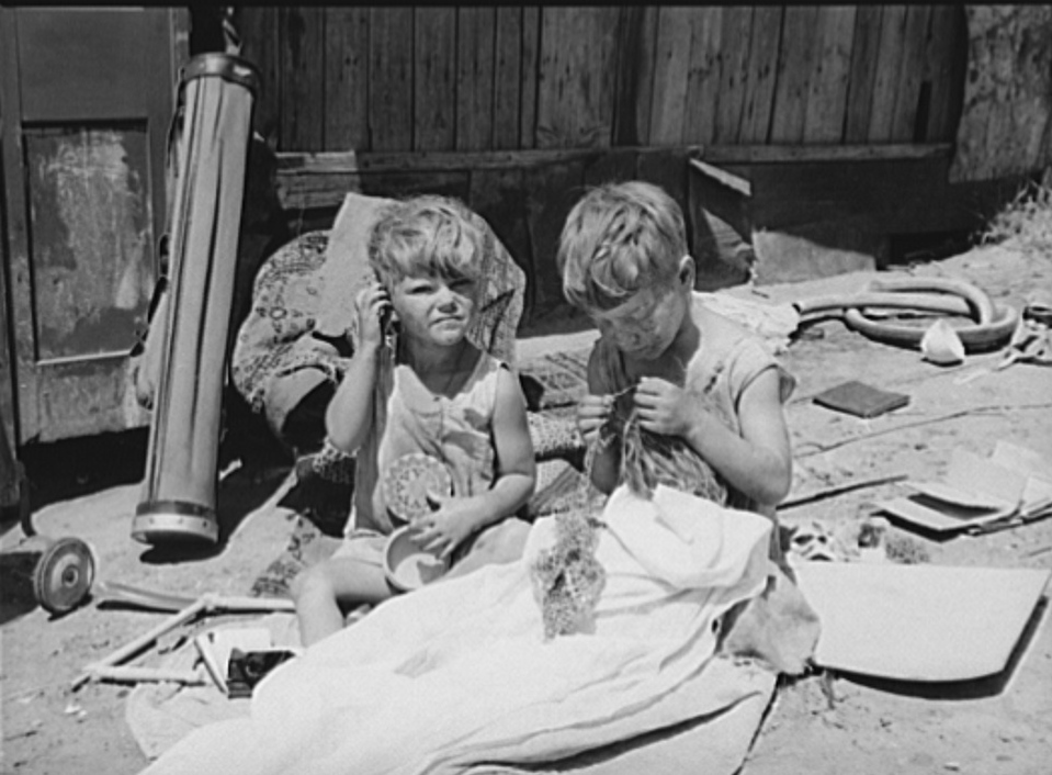 Children of Mays Avenue camp. Oklahoma City, Oklahoma. Their father is a trasher and they are playing with some things he picked up