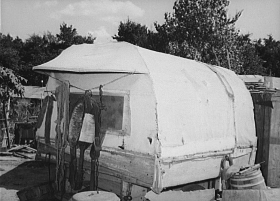 Covered trailer in community camp. Oklahoma City, Oklahoma