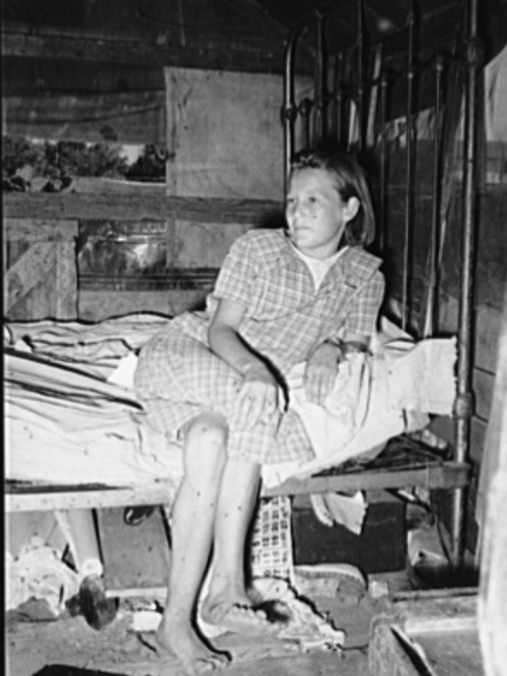 Daughter of family living in Mays Avenue camp. Oklahoma City, Oklahoma. This family had been farmers in Oklahoma until four years ago