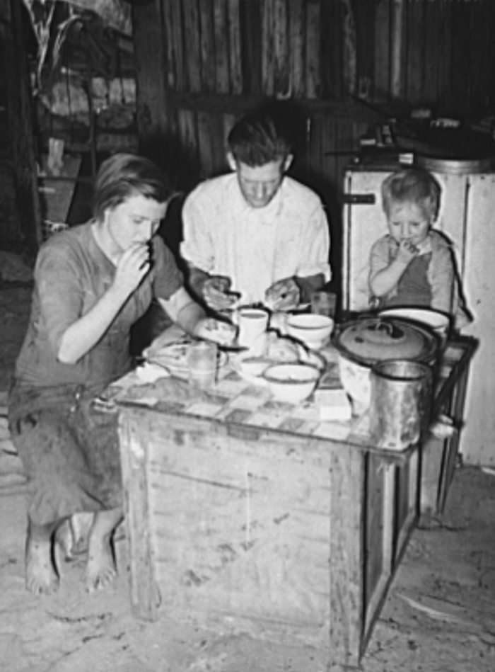 Family eating breakfast. Mays Avenue camp, Oklahoma City, Oklahoma