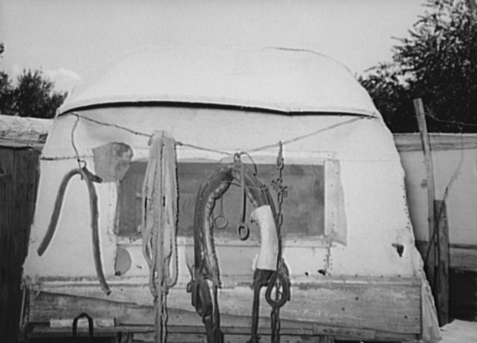 Harness and rope on back of covered trailer in Mays Avenue camp. Oklahoma City, Oklahoma