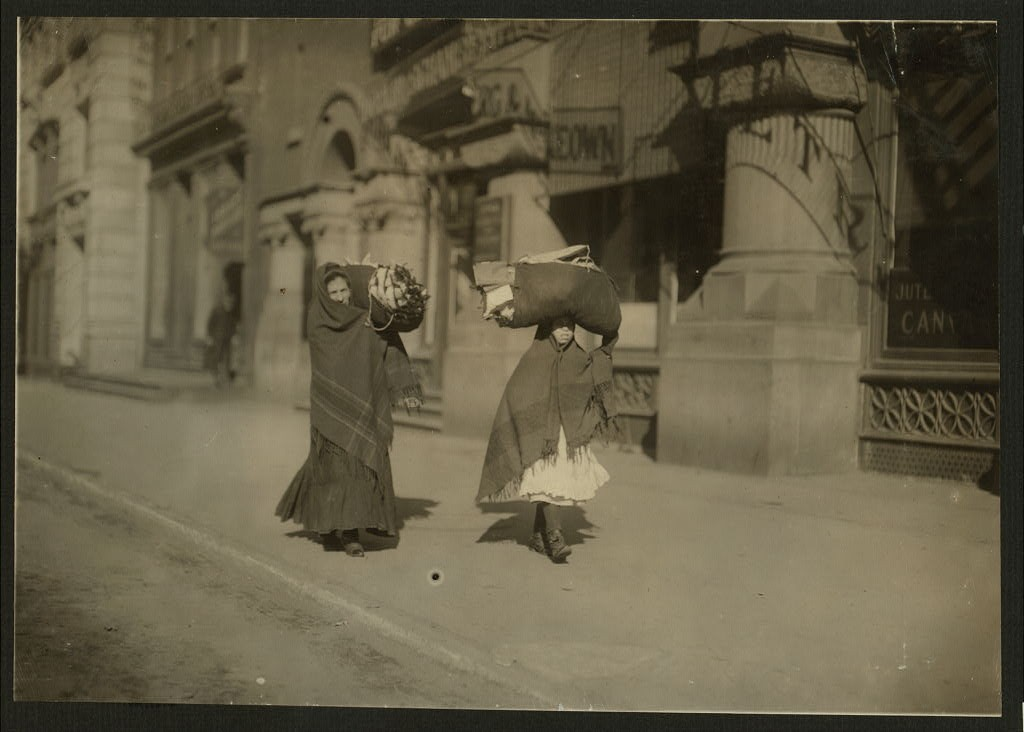 Heavy loads of garments for home-work. Near Bleeker St., N.Y. Location New York, New York Feb. 1912