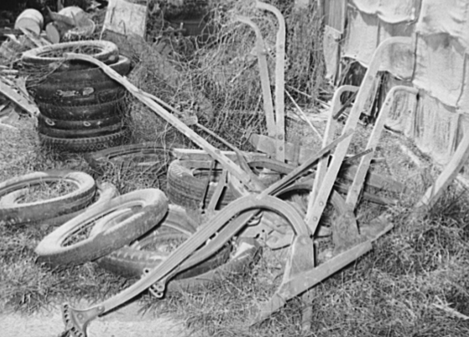 Old plows and wornout tires. Testimonial to the sources of the residents of the community camp. Oklahoma City, Oklahoma