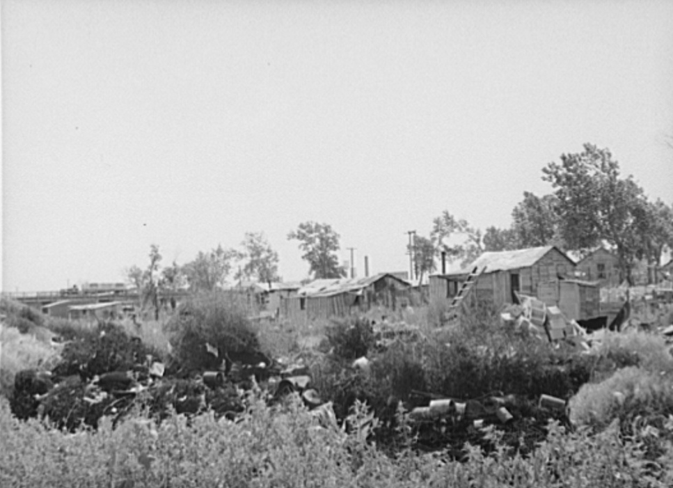 Part of Mays Avenue camp with dump in foreground.