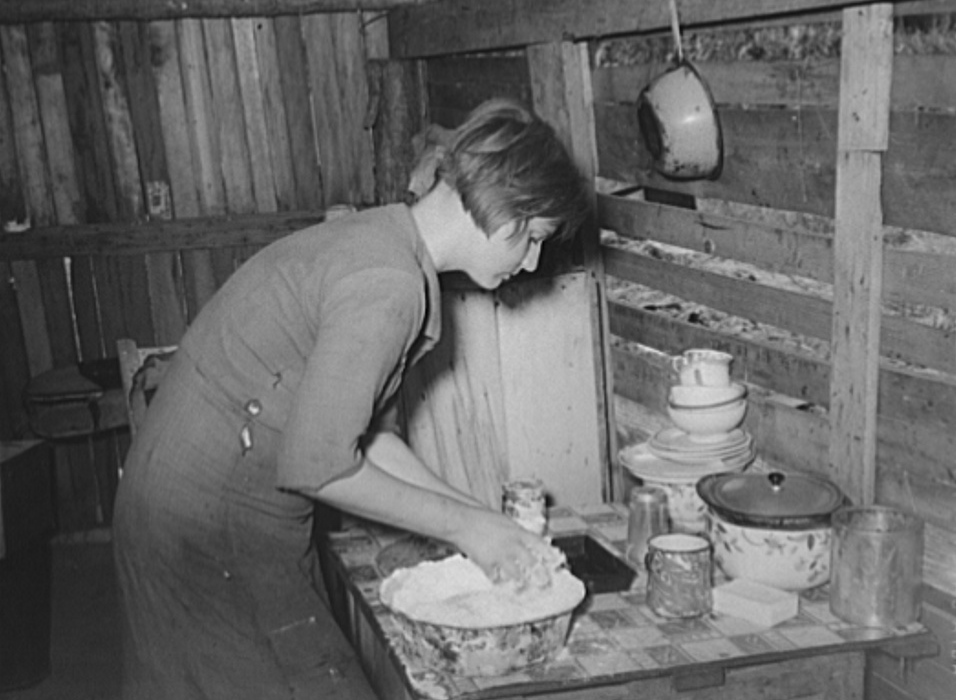 Resident of Mays Avenue camp making biscuits. Oklahoma City, Oklahoma