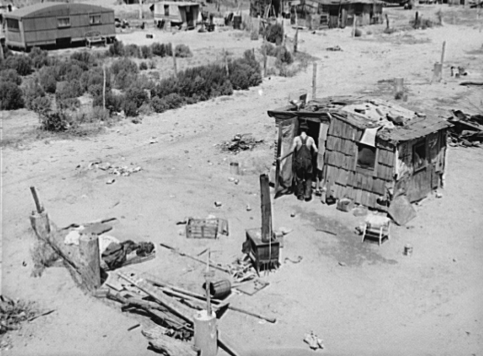 Shack home and yard. Mays Avenue camp, Oklahoma City, Oklahoma. Notice crude fence made of old water boilers and discarded fencing