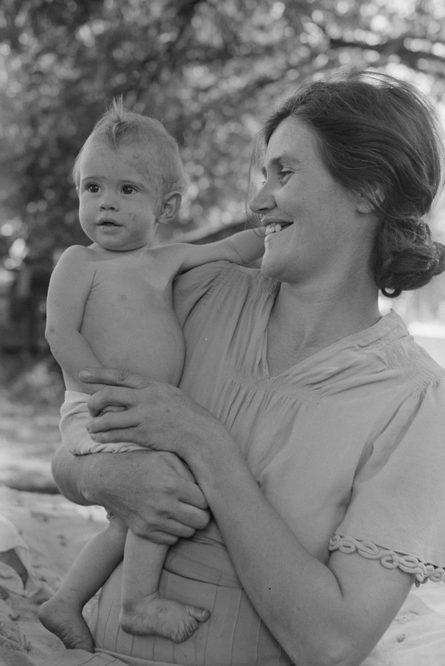 Wife of carpenter and her baby who live in community camp, Oklahoma City, Oklahoma2