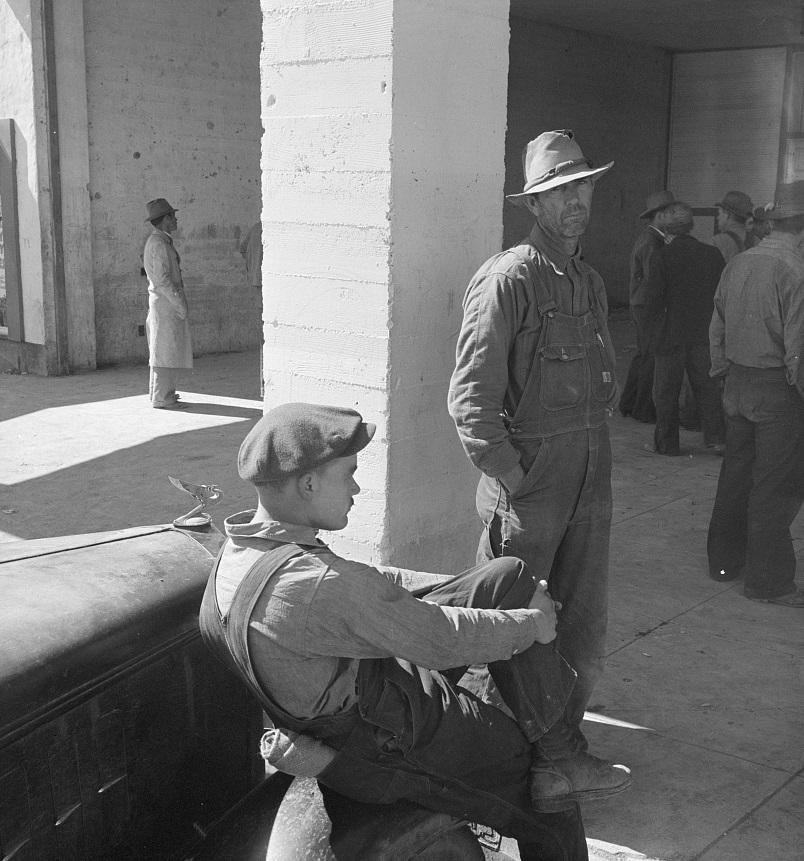 Pea pickers waiting at Farm Security Administration (FSA) office for issue of surplus commodities. Calipatria, California 1939 Dorothea Lange