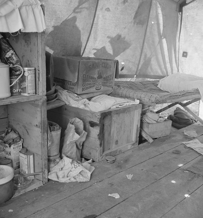 Tent interior in a pea pickers' camp. Food supply and household equipment. Santa Clara County, California 1939 Dorothea Lange