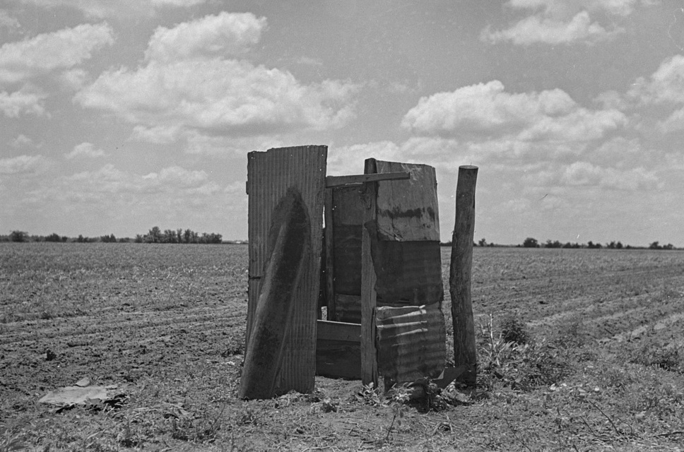Old privy on sharecropper's farm by Photographer Russell Lee 1938