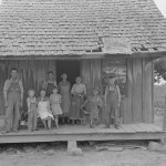 Sharecropper family on front porch Southeast, Missouri by Photographer Russell Lee 1938