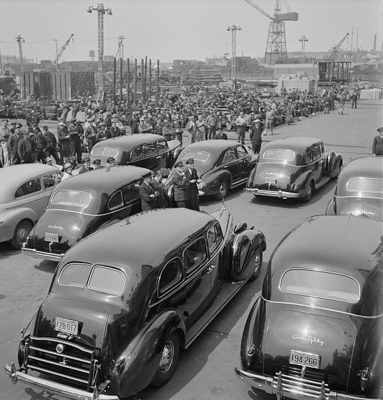 Bethlehem-Fairfield shipyards, Baltimore, Maryland. Automobiles used to transport a launching party (Arthur S. Siegel, Library of Congress)